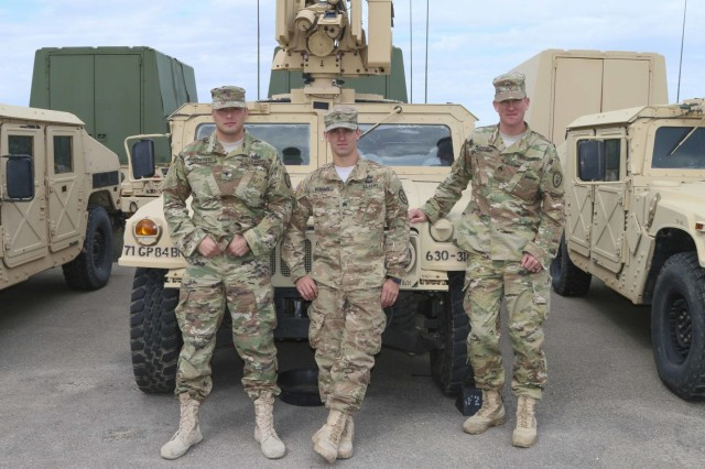 (From left to right) Spc. Ryan Stratis, Sgt. Zachary McDaniel and Staff Sgt. Christian Mason, all assigned to the 630th Ordnance Company, 84th Ordnance Battalion (Explosive Ordnance Disposal), 71st Ordnance Group, pose in front of their vehicle Oct. 13 in the unit's motorpool at Fort Riley. The three Soldiers competed and placed second overall in the third annual Department of the Army Ordnance Corps EOD Team of the Year Competition hosted by Fort A.P. Hill, Virginia, Sept. 12-16. (Sgt. Takita Lawery, 19th PAD)