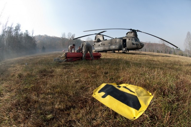 Soldiers with the 59th Aviation Troop Command continued their support of the South Carolina wildfires over Thanksgiving Day, Nov. 24, 2016, with CH-47 Chinook and UH-60 Black Hawk helicopters used to pour water on the fires with a Bambi Bucket.