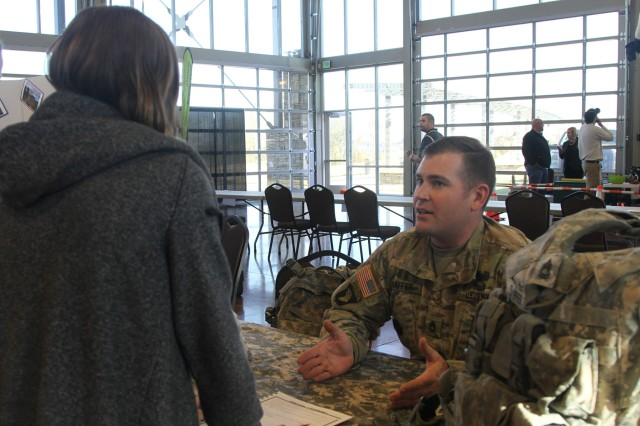 Sgt. 1st Class Shannon Shaffer, a combat engineer with 101st Airborne Division (Air Assault) Sustainment Brigade, 101st Abn. Div., speaks to a student, Nov. 16, 2016, during the Eighth-Grade Career Exploration Day hosted by the Clarksville-Montgomery County School System at the Wilma Rudolph Event Center in Clarksville, Tn. (U.S. Army photo by Sgt. Neysa Canfield/101st Airborne Division Sustainment Brigade Public Affairs)
