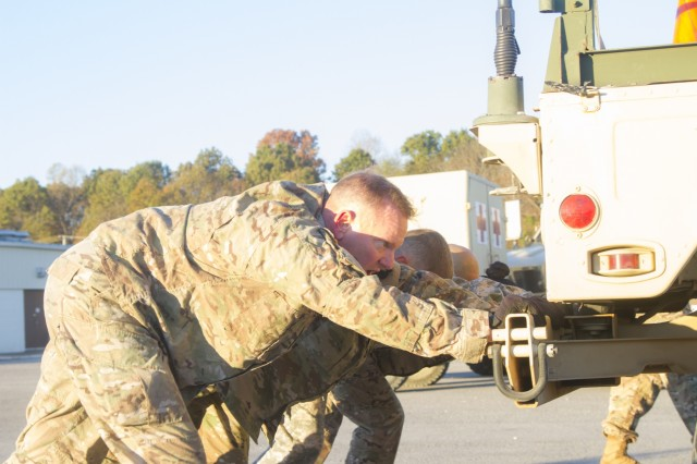 Col. Stanley Sliwinski, commander of the 101st Airborne Division (Air Assault) Sustainment Brigade, 101st Abn. Div., pushes a High Mobility Multipurpose Wheeled Vehicle with his team, Nov. 9, 2016, during the Command Team Physical Training Challenge at the 74th Composite Transportation Company motor pool on Fort Campbell, Ky. (U.S. Army photo by Sgt. Neysa Canfield/101st Airborne Division Sustainment Brigade Public Affairs)