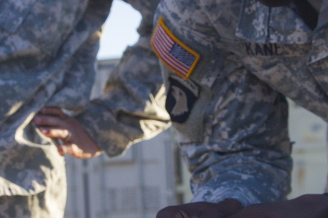 Capt. Abdoul R. Kane, commander for Headquarters and Headquarters Company, 101st Special Troops Battalion, 101st Airborne Division (Air Assault) Sustainment Brigade, 101st Abn. Div., attempts to place a third hex nut on a stack with a chopstick, Nov. 9, 2016, during the Command Team Physical Training Challenge at the 74th Composite Transportation Company motor pool on Fort Campbell, Ky. (U.S. Army photo by Sgt. Neysa Canfield/101st Airborne Division Sustainment Brigade Public Affairs)