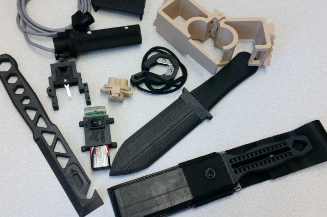 These parts were made using additive manufacturing, which creates plastic items and other durable components by adding material, layer by layer, using 3-D printers. (U.S. Army photo)