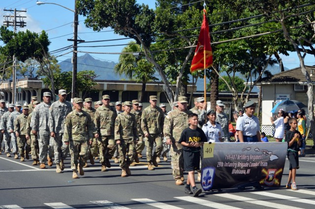 Members of the 1st Battalion, 487th Field Artillery Regiment, 29th Brigade Combat Team of the Hawaii National Guard march during the 70th Annual Wahiawa Veterans Day parade at Wahiawa, Hawaii, on Nov. 11, 2016. The Wahiawa parade is the oldest Veterans Day parade in the state of Hawaii. (U.S. Army photo by Staff Sgt. Armando R. Limon, 3rd Brigade Combat Team, 25th Infantry Division)