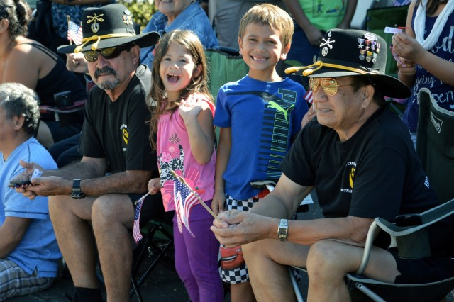 U.S. Army veterans and their families watch the 70th Annual Wahiawa Veterans Day parade at Wahiawa, Hawaii, on Nov. 11, 2016. The Wahiawa parade is the oldest Veterans Day parade in the state of Hawaii. (U.S. Army photo by Staff Sgt. Armando R. Limon, 3rd Brigade Combat Team, 25th Infantry Division)