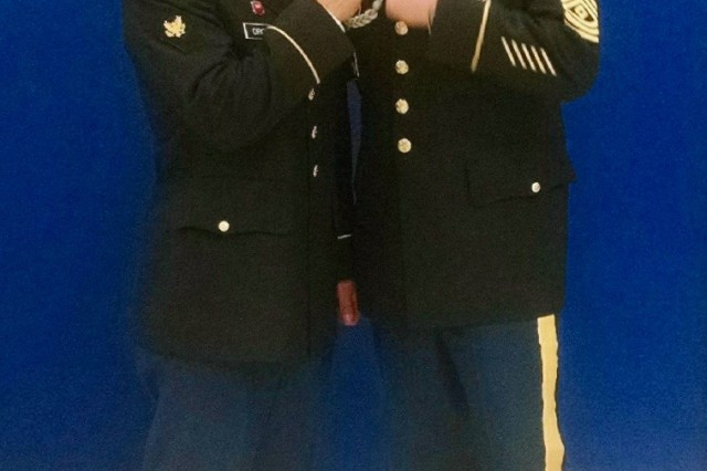 1st Sgt Mitter, right, poses with Spc. Michael Orozco, winner of the 2016 United States Army Reserve Best Warrior competition at Schwab Army Reserve Center, Joint Base Lewis-McChord, WA, February 2016. Both soldiers are with the 315th Engineer Battalion, 301st Maneuver Enhancement Brigade.
