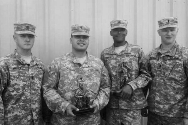 1st Sgt. Mitter, left, poses for a photograph with soldiers from the 387th Engineer Company, 315th Engineer Battalion, 301st Maneuver Enhancement Brigade at the 387th Engineer Company Best Warrior competition, September 22.