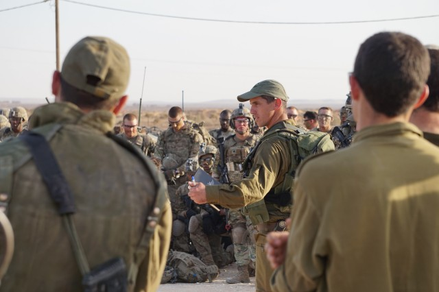 A Soldier in the Givati Brigade, Israeli Defense Force instructs Troopers assigned to Lightning Troop, 3rd Squadron, 2nd Cavalry Regiment, U.S. Army during a training exercise in Ma'ala, Israel Nov. 3 -- 13, 2016. Exercise Lightning Shock provided the Regiment and the IDF with the ability to plan, prepare and execute combined training and build upon the readiness of the two armies. (Courtesy Photo from Lightning Troop, 3rd Squadron, 2nd Cavalry Regiment)