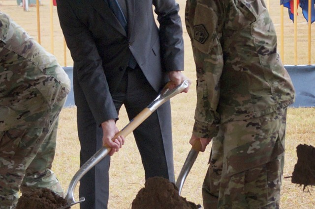 Secretary of the Army Eric K. Fanning and Lt. Gen. Paul M. Nakasone, commander of U.S. Army Cyber Command and Second Army, join in turning the first shovelfuls of earth in a ceremonial groundbreaking marking the start of construction on the Army Cyber Command Complex at Fort Gordon, Ga., Nov. 29, 2016.