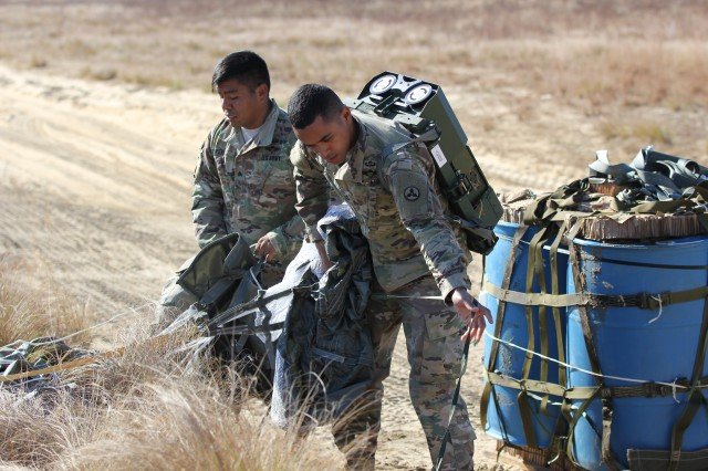 Sergeant Manuel Perez (left), a malfunctions NCO and Pfc. Curtis Neal(right), a Parachute Rigger, both Soldiers with the 647th Quartermaster (Corps Aerial Delivery) Company, recover a Joint Precision Airdrop System (JPADS) during operations, Nov. 16, 2016, on Normandy Drop Zone at Ft. Bragg, N.C. The JPADS is a GPS guided system that can accurately deliver airdropped supplies to a specific point. The JPADS were the first to be tested on Fort Bragg since 2013. U.S. Army Photo by Maj. Allison Aguilar.