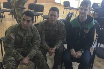 'Sky Soldiers' break from training to spend the afternoon with Latvian students