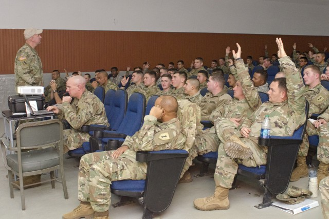 CAMP HOVEY, Republic of Korea -- Soldiers from the 1st Armored Brigade Combat Team, 1st Infantry Division, respond to a question posed by Command Sgt. Maj. Alan Hummel, senior enlisted leader to the Armor School at the Maneuver Center of Excellence, Fort Benning, Ga., during the Armor School's visit at the Hovey Multipurpose Complex, Camp Hovey, South Korea, Nov 29.
