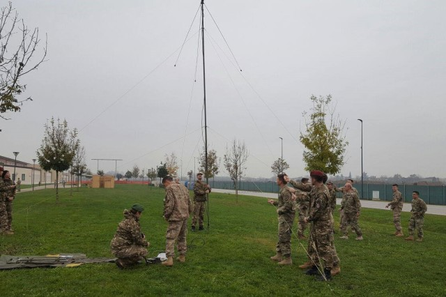 U.S. Army paratroopers assigned to Charlie Company, 54th Brigade Engineer Battalion (Airborne), 173rd Infantry Brigade Combat Team (Airborne) teach U.S. and Slovenian RTO's how setup and OE-254 antenna to establish line-of-sight FM communications on November 16, 2016 on Caserme Del Din, Vicenza, Italy.