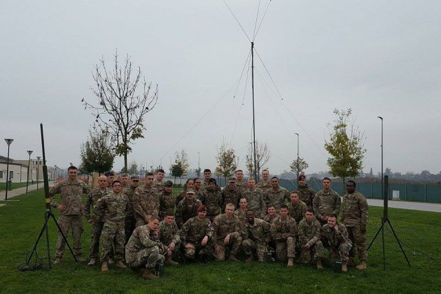 U.S. Army paratroopers assigned to the 173rd Airborne Brigade Signal Company and Slovenian 1st Brigade Signal Company pose for a NATO ally team building photo after the culminating practical exercise of the RTO Academy on November 16, 2016 on Caserme Del Din, Vicenza, Italy.