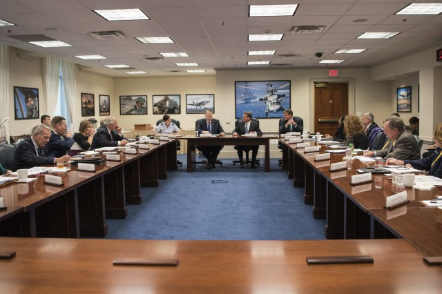 Secretary of Defense Ash Carter and Deputy Secretary of Defense Bob Work meet with representatives from military and veteran service organizations at the Pentagon in Washington, D.C., Nov. 30, 2016.