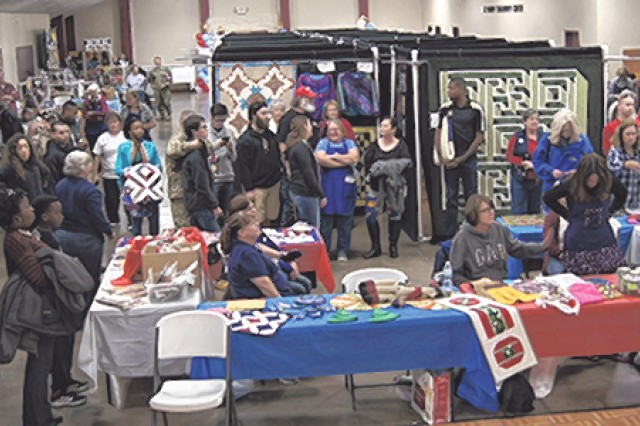 Quilt makers, recipients and attendees gather for the final award presentation during the Gone To Pieces Quilt Show.
