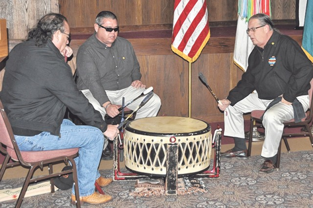 John Big Horse, Scott Big Horse and Kenneth Big Horse, all members of the Osage Nation, perform a musical demonstration at the American Indian Heritage Month event Nov. 22 at the John B. Mahaffey Museum.