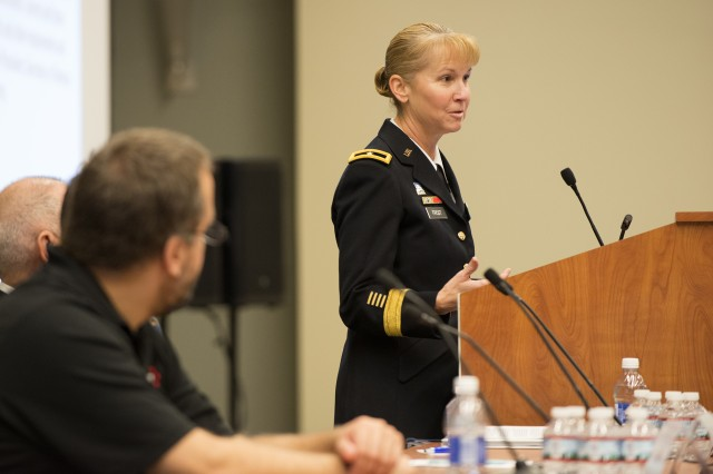 Brig. Gen. Patricia Frost, director of cyber for the Army's G-3/5/7, talks about the efforts behind integrating cyber and electronic warfare during a panel discussion hosted by the Association of the Old Crows in Washington, D.C., Dec. 1, 2016.