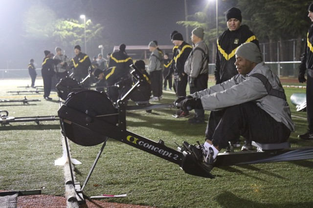 Senior Leaders participate in the Physical Readiness Training, getting ready to exercise on a rower at Camp Walker Kelley Field.