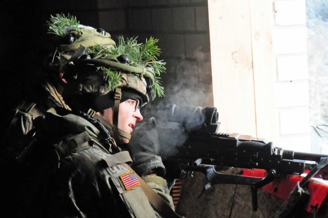 "A Paratrooper from Able Company, 2nd Battalion, 503rd Infantry Regiment, 173rd Infantry Brigade Combat (Airborne), uses a building as cover as he fires upon the ""enemy"" during an exercise at an urban training center Nov. 29 in Pabrade, Lithuania. The assault was part of Exercise Iron Sword 2016. Iron Sword is an international training exercise featuring 11 NATO countries and about 4,000 troops."