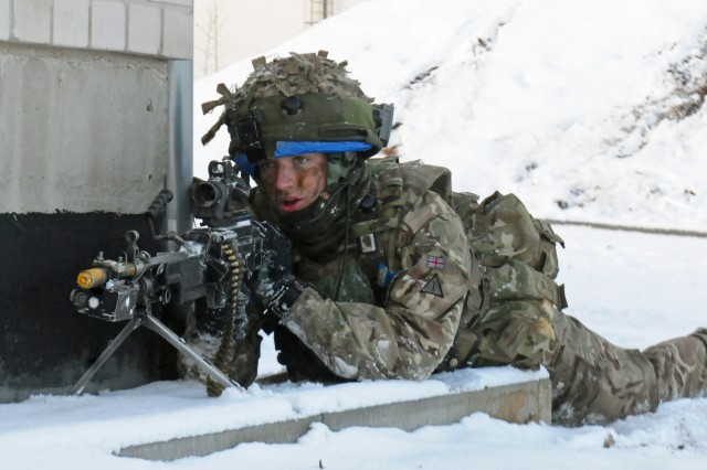 A Soldier from the 1st Battalion Mercian Regiment, British Armed Forces, returns fire during an assault on an urban training center Nov. 29 in Pabrade, Lithuania. The assault was part of Exercise Iron Sword 2016. Iron Sword is an international training exercise featuring 11 NATO countries and about 4,000 troops.
