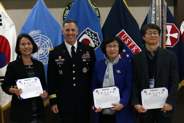 Eighth Army Commanding General Lt. Gen. Thomas S. Vandal poses for a photo after presenting Certificates of Appreciation to several awardees for their hard work on the Korean Head-Start Program during the 10th anniversary of the program at Pyeongtaek University, South Korea, Nov. 29, 2016.  The Korean Head-Start Program started in 2006 for United States Forces Korea newcomers to strengthen the ROK-U.S. alliance by introducing them to a variety of elements which include Korean culture, history, traditional etiquette and basic Korean language.