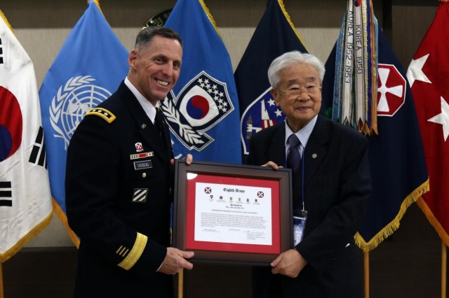 Eighth Army Commanding General Lt. Gen. Thomas S. Vandal poses for a picture with Lee Pil-jae, President of Pyeongtaek University, after presenting him with a Certificate of Appreciation for his hard work on the Korean Head-Start Program during the 10th anniversary of the program at Pyeongtaek University, South Korea, Nov. 29, 2016. The Korean Head-Start Program started in 2006 for United States Forces Korea newcomers to strengthen the ROK-U.S. alliance by introducing them to a variety of elements which include Korean culture, history, traditional etiquette and basic Korean language.