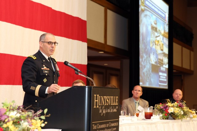 Gen. Gus Perna gives the keynote address at the Redstone Update to more than 500 leaders from throughout the Tennessee Valley Nov. 30 at the Von Braun Center North Hall in Huntsville, Alabama. Perna is the commanding general of Army Materiel Command.