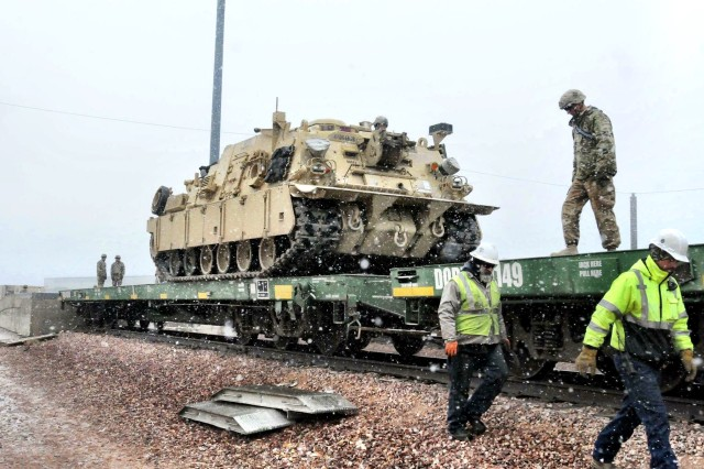 FORT CARSON, Colorado -- A Soldier from 64th Brigade Support Battalion, 3rd Armored Brigade Combat Team, 4th Infantry Division, prepares to tie down an M88A2 recovery vehicle to a train car at Fort Carson, Colorado, Dec. 2, 2016. The train is the last of 12 hauling more than 2,000 pieces of rolling stock ultimately destined for Bremerhaven, Germany, where 3rd Brigade will receive its full set of ABCT equipment before onward movement to Poland for its deployment in support of Operation Atlantic Resolve. The arrival of the heavy brigade in January will mark the beginning of a continuous presence of an armored brigade combat team in central and eastern Europe, strengthening NATO deterrence and defense efforts. (Photo by Staff Sgt. Ange Desinor, 3rd Armored Brigade Combat Team, 4th Infantry Division Public Affairs)