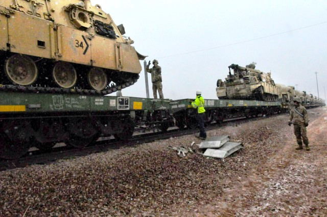 FORT CARSON, Colorado -- A Soldier from 64th Brigade Support Battalion, 3rd Armored Brigade Combat Team, 4th Infantry Division, guides an M88A2 recovery vehicle onto a train car at Fort Carson, Colorado, Dec. 2, 2016. The train is the last of 12 hauling more than 2,000 pieces of rolling stock ultimately destined for Bremerhaven, Germany, where 3rd Brigade will receive its full set of ABCT equipment before onward movement to Poland for its deployment in support of Operation Atlantic Resolve. The arrival of the heavy brigade in January will mark the beginning of a continuous presence of an armored brigade combat team in central and eastern Europe, strengthening NATO deterrence and defense efforts. (Photo by Staff Sgt. Ange Desinor, 3rd Armored Brigade Combat Team, 4th Infantry Division Public Affairs)