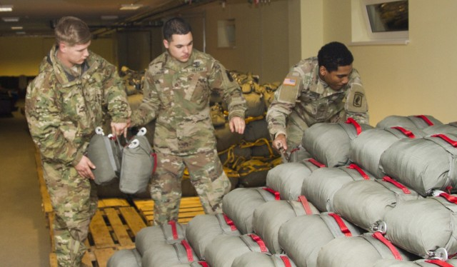 Parachute riggers establish readiness one parachute at a time
