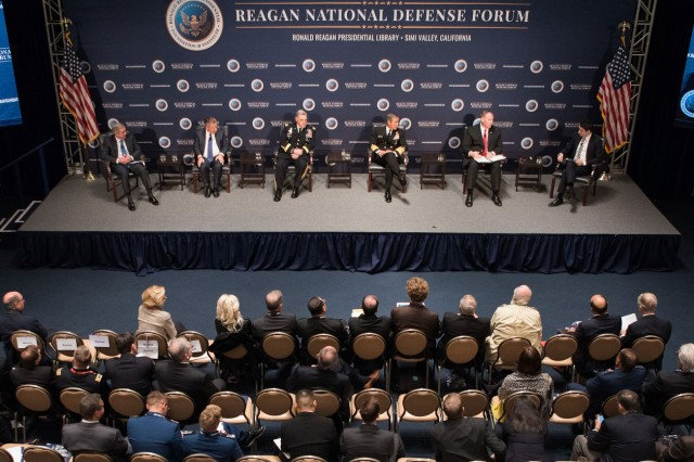 Deputy Defense Secretary Bob Work, second from right on stage, and other defense leaders participate in a panel discussion at the Reagan National Defense Forum in Simi Valley, Calif., Dec. 3, 2016.