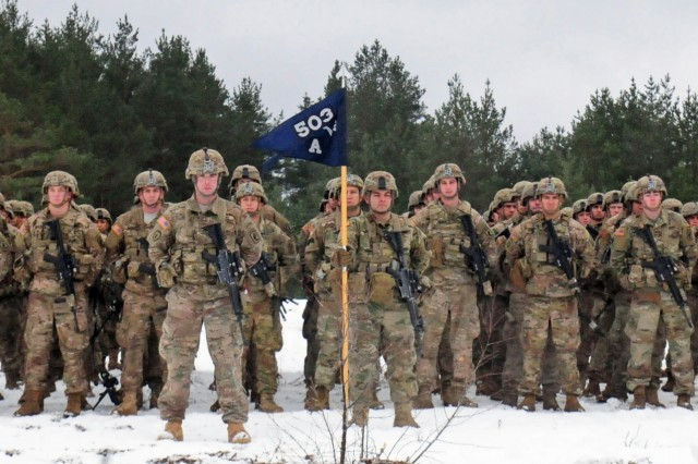 PABRADE, Lithuania - Paratroopers from Able Company, 2nd Battalion, 503rd Infantry Regiment, 173rd Infantry Brigade Combat (Airborne), stand in formation during the closing ceremonies for Iron Sword 2016 Dec. 2. Iron Sword is an international training exercise featuring 11 NATO countries and about 4,000 troops. The exercise is designed to test promote regional stability and security, while strengthening partnership capacity, and fostering trust while improving the ability to conduct joint training between Lithuania, the U.S., and NATO member nations.