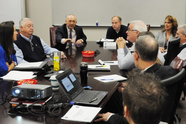 Larry Franz, ARMS Program Manager, discusses the ARMS process with Army Contracting Command- Rock Island personnel during the workshop, December 1. Since its inception in 1993, the ARMS Program has generated $558.4 million in cost savings.