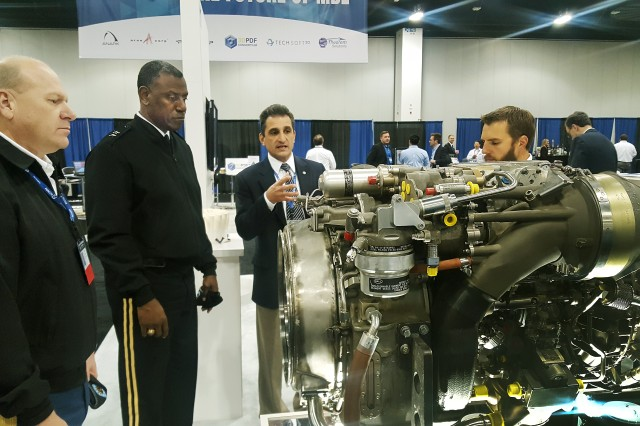 Command Sgt. Maj. James Snyder (left) and Maj. Gen. Cedric Wins (second to left) view manufacturing technology at the 2016 Defense Manufacturing Conference in Denver Nov. 29.