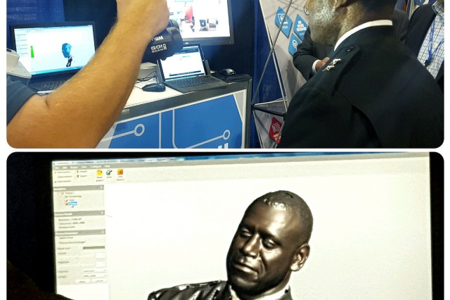 An exhibitor scans the face of Maj. Gen. Cedric Wins at the 2016 Defense Manufacturing Conference in Denver Nov. 29.