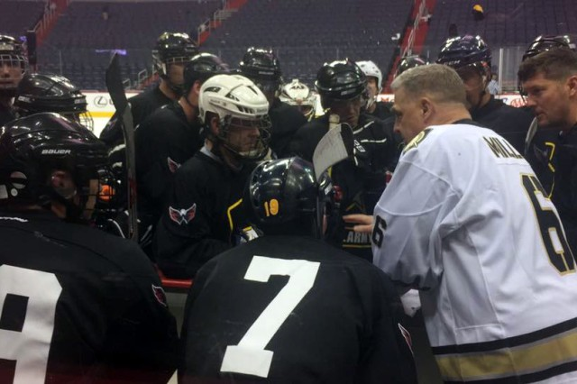 Army hockey coach and also Army Chief of Staff Gen. Mark A. Milley (right) plots strategy against Navy at game start at the Verizon Center in Washington, D.C., Dec. 5, 2016.