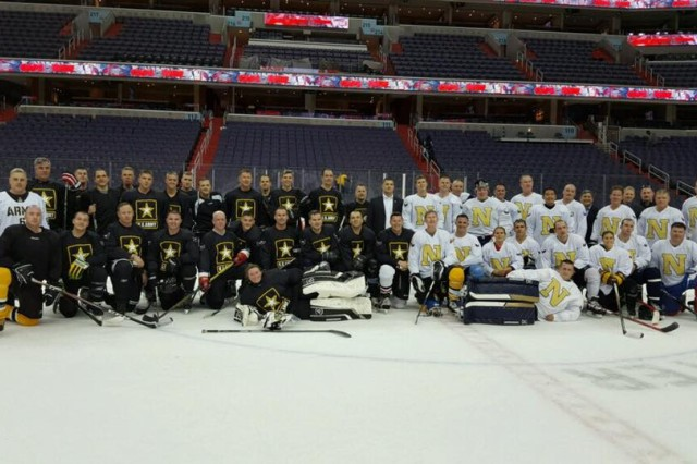 The Army and Navy teams pose for an after-game photo at the Verizon Center in Washington, D.C., Dec. 5, 2016.