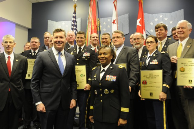 "Hon. Patrick Murphy, Under Secretary of the Army, poses with some of the award recipients during the Army Community Partnership Program 2016 recognition ceremony held at the Pentagon's ""Hall of Heroes."""