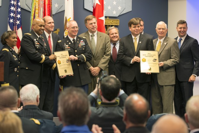 Under Secretary of the Army Patrick Murphy, far right, and Lt. Gen. Gwen Bingham, far left, the  Army's assistant chief of staff for installation management, pose for a photograph with representatives from the Redstone Arsenal partnerships in Alabama during the inaugural Army Community Partnership Recognition Ceremony at the Pentagon in Washington, D.C., Dec. 6, 2016. The Army National Guard in Alabama and New Jersey, Presidio of Monterey, Camp Guernsey, and all of their partners were also honored.