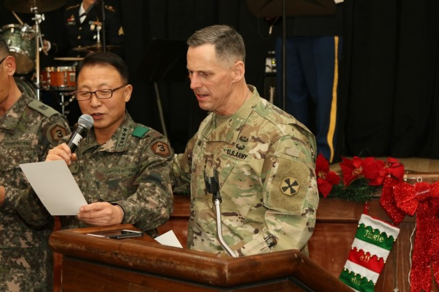 Third Republic of Korea Army Commanding General, Gen. Eom Ki-hak, and Eighth Army Commanding General Lt. Gen. Thomas S. Vandal sing a song during the annual Eighth Army-TROKA Fall Festival at Camp Humphreys, South Korea, Dec. 2. The festival is intended to enhance the combined operation capabilities and strengthen the alliance between the two units through static displays, site tours, briefings and team-building activities.