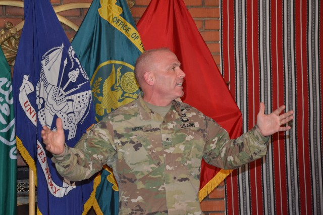 Brig. Gen. Frank Muth, Program Manager for the Office of the Program Manager for the Saudi Arabian National Guard, welcomes OPM-SANG and Ministry of the Interior-Military Assistance Group personnel to the final Town Hall meeting of 2016 at the Desert Rose Dec. 7.