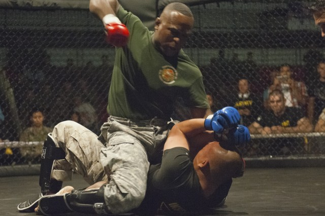 Sgt. 1st Class Jeff Duncan punches Marine Sgt. Be Vang, Marine Corps Detachment, in the Cruiserweight match of the 2016 Fort Leonard Wood Combatives tournament held in November.