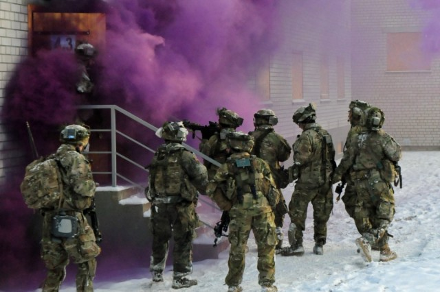 Paratroopers from Able Company, 2nd Battalion, 503rd Infantry Regiment, 173rd Airborne Brigade, prepare to enter a building Nov. 29, 2016, in Pabrade, Lithuania. The assault was part of Exercise Iron Sword 2016 in support of Atlantic Resolve. Iron Sword is an international training exercise featuring 11 NATO countries and about 4,000 troops. The U.S. and partner nations conducted land, sea and air exercises and maintained a rotational presence in order to reinforce NATO security commitments in Europe.