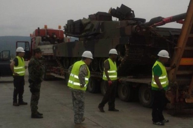 Master Sgt. Tom Anderson (center) and others receive an M1A2 Abrams tank, May 13 in Bulgaria. Anderson is an operations NCO with the Army Sustainment Command-Army Reserve Element at Rock Island Arsenal, Illinois, and is currently serving with the Army Prepositioned Stocks 2-Bulgaria.