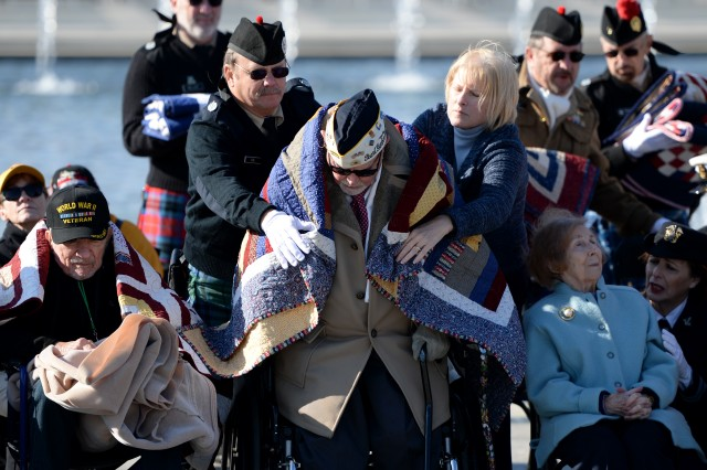 Retired Air Force Chief Warrant Officer Jay C. Groff Jr. is covered with a Quilt of Valor that was given to all the World War II veterans during the 2016 Pearl Harbor Remembrance Day 75th Anniversary Commemoration at the World War II Memorial in Washington, D.C., Dec. 7, 2016. Stationed at Hickam Field in Oahu, Hawaii, Groff heard an explosion on Dec. 7, 1941, and raced out of the barracks to defend against the attack.
