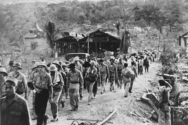 A captured Japanese photograph shows the start of the bloody Bataan Death March, Mariveles, Philippines, April 1942, after Americans surrendered following four months of desperate combat. Thousands of American and Filipino prisoners of war would die on the 60-mile trek to prison camps, whether from dehydration, exhaustion or murder. Survivors would endure four years of torture, starvation, disease and slave labor. Almost half never made it home.