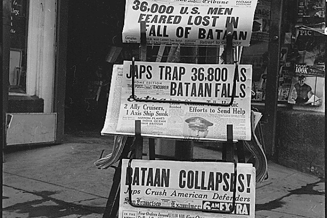 American newspapers record the fall of Bataan, April 9, 1941. In the largest surrender in American history, about 80,000 Americans were taken prisoner by the Japanese, and forced to endure four years of torture, starvation, disease and slave labor. Almost half never made it home.