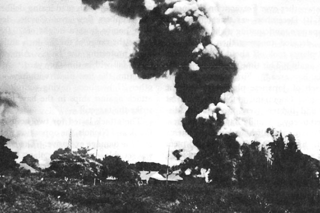 Nichols Field in the Philippines burns, Dec. 10, 1941. An eyewitness said Japanese attacks destroyed everything in a matter of minutes. Between attacks at Clark, Iba and Nichols fields, the Far East Air Force was destroyed, and with it any hope for defending the Philippines. Americans finally surrendered after months of fighting without food, adequate ammunition or reinforcements.