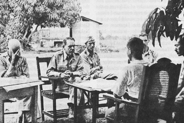 Maj. Gen. Edward P. King Jr., second from left, discusses surrender terms with Japanese commanders on Bataan, Luzon Island, Philippines. Soldiers had been in constant combat for four months without food, adequate ammunition or reinforcements. Although they wanted to continue the fight, King believed it would be suicide and surrendered almost 80,000 men against explicit orders. It was the largest surrender in American military history, and King fully expected to be court-martialed after the war. Col. Everett C. Williams is on the left, Maj. Wade Cothran is right of King and Maj. Achille C. Tisdelle is far right.