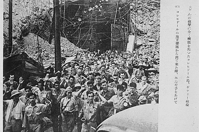 In this captured Japanese photograph, U.S. and Filipino servicemen surrender to Japanese forces, Corregidor, Philippines, May 6, 1942. Americans had fought for months without food, adequate ammunition or reinforcements, and would now endure four years in brutal captivity.